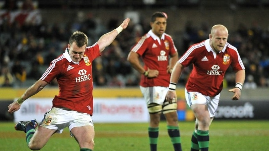 Stuart Hogg (left) of the British and Irish Lions kicks for goal during the tour match in Canberra on June 18, 2013. The British and Irish Lions crashed to their first loss on tour in Australia when they were upset 14-12 by the tenacious ACT Brumbies just days out from the opening Test against the Wallabies.