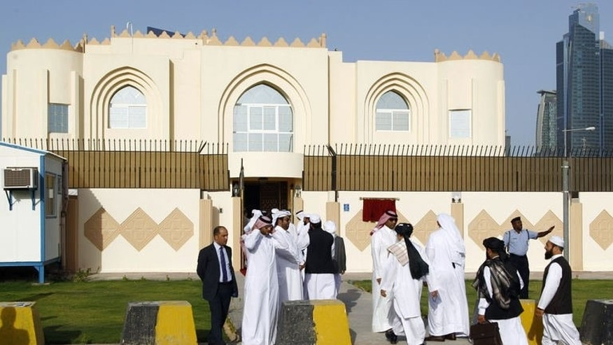 Guests arrive for the opening ceremony of the new Taliban political office in Doha on June 18, 2013. British Prime Minister David Cameron said the United States was doing the right thing by meeting with Taliban representatives after the Afghan militants opened an office in Qatar.