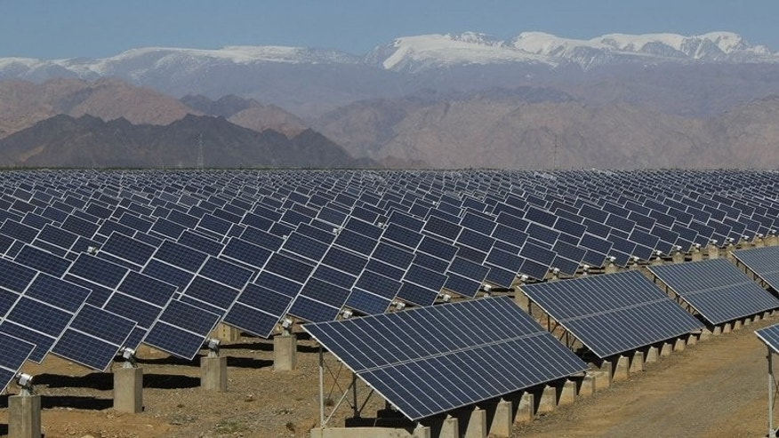 Large solar panels in Hami, China's Xinjiang region, on May 8, 2013. China said on Tuesday it will hold this week talks with the European Union in a bid to resolve a dispute over solar panels and other business issues, as tensions between the two risk escalating into a trade war.