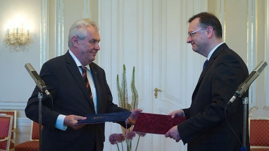 Czech President Milos Zeman (L) accepts the resignation of Prime Minister Petr Necas and his coalition government at Prague Castle on June 17, 2013. Czech political leaders were scrambling Tuesday to find a new prime minister or face snap elections, after Necas stepped down over a massive bribery and spying scandal involving his top aide and alleged lover.