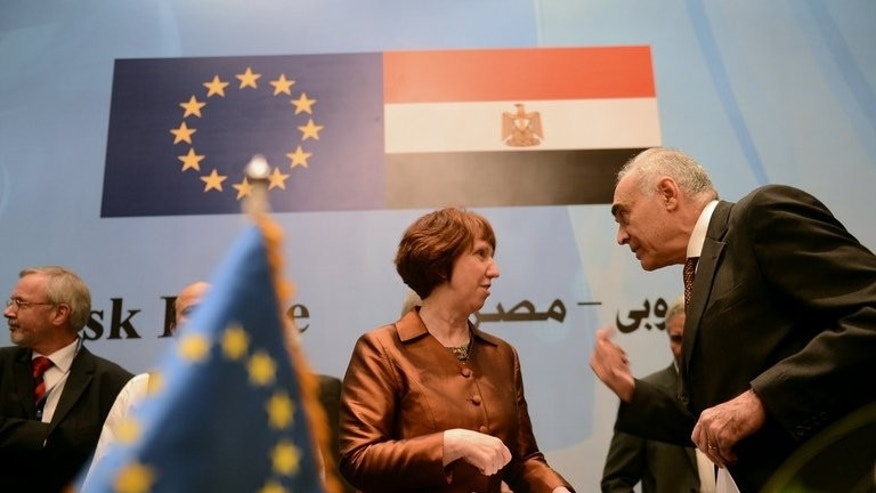 Catherine Ashton of the EU with Egypt's Mohamed Kamel Amr at an aid deal signing ceremony in Cairo last November. A billion euros of EU aid channelled to Egypt before and after the January 2011 uprising that ended Hosni Mubarak's reign failed to improve human rights and governance, or reduce corruption, auditors said Tuesday.