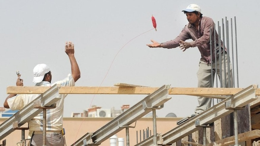 Foreign labourers work at a construction site in the Saudi capital Riyadh on April 10, 2013. The flow of foreign direct investment into Arab states, including those hit by uprisings, rose by 9.8 percent last year despite the unrest but remained well below their 2010 level, a report said.