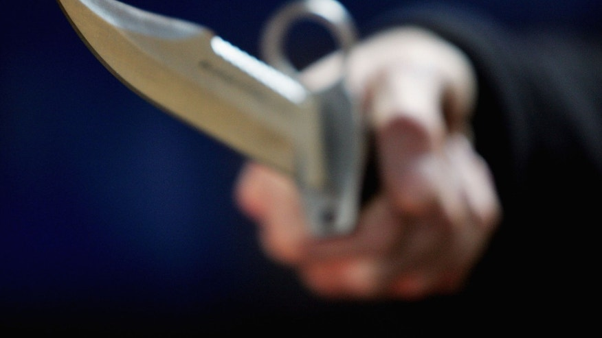 LONDON, DECEMBER 13:  A hunting knife is held by an employee at a film and television prop company December 13, 2004 in London, England. Families of stabbing victims have called on the government to make carrying a knife as serious an offence as carrying a gun, with a minimum five-year jail term for carrying a knife with a blade longer than three inches. (Photo Illustration by Ian Waldie/Getty Images)