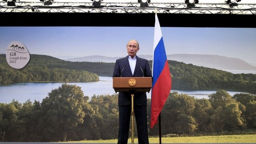 Russian President Vladimir Putin speaks during a press conference at the end of the G8 summit at the Lough Erne golf resort in Enniskillen, Northern Ireland, on June 18, 2013.