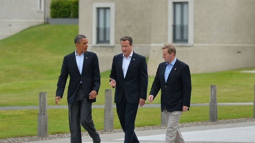 US President Barack Obama (L), Britain's Prime Minister David Cameron (C) and Irish Prime Minister Enda Kenny (R) walk and talk on the second day of the G8 summit at the Lough Erne resort near Enniskillen in Northern Ireland on June 18, 2013.