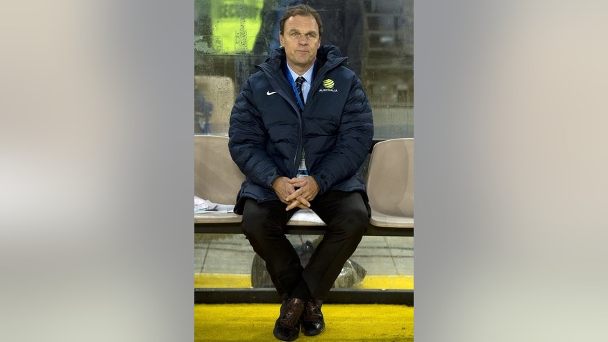 Australia's coach Holger Osieck watches his team during their 2014 World Cup qualifier against Iraq, in Sydney, on June 18, 2013. Australia secured their place at the Cup finals in Brazil with a late strike from Josh Kennedy firing them to a tense 1-0 win over an under-strength Iraq, at Stadium Australia.