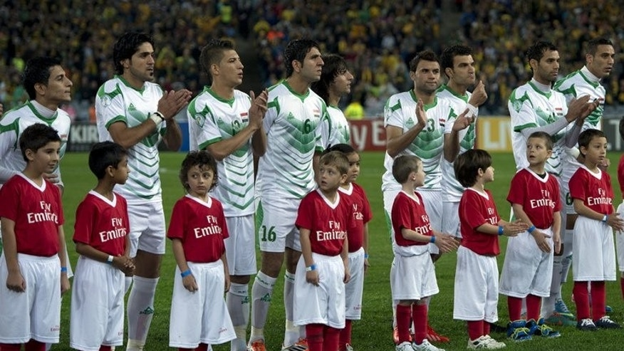 Iraq's players clap a the end of their national anthem prior to their match against Australia, their 2014 World Cup qualifier, in Sydney, on June 18, 2013. Australia secured their place at the Cup finals in Brazil with a late strike from Josh Kennedy firing them to a tense 1-0 win over an under-strength Iraq at Stadium.