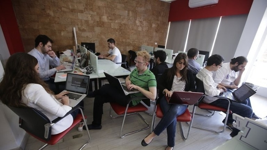 "Lebanese entrepreneurs from different internet start-up companies work in the offices of ""accelerator"" Seeqnce in Beirut's Hamra district, on April 24, 2013. Lebanon has long suffered with some of the slowest Internet speeds in the world, but a new crop of online entrepreneurs believes their country is primed for a tech start-up boom."