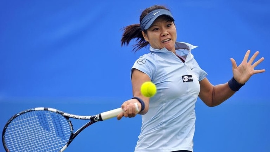 China's Li Na hits a return during her women's singles match against France's Alize Cornet on the fourth day of the AEGON International tennis tournament in Eastbourne, southern England on June 18, 2013. Li won 6-2, 6-4.