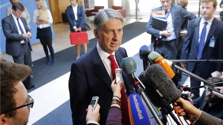 British Defence Secretary Philip Hammond speaks to the media before attending a defence ministers' meeting on June 4, 2013 at the NATO headquarters in Brussels. More than 4,000 soldiers are to learn on Tuesday that they have lost their jobs in the latest round of army cuts, with more still to come, the Ministry of Defence said.