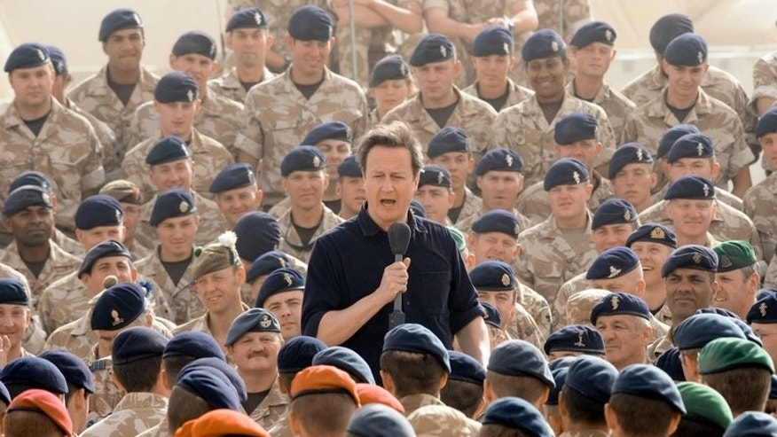 British Prime Minister David Cameron addresses British soldiers at Camp Bastion in Helmand Province, Afghanistan, on June 11, 2010. More than 4,000 soldiers are to learn on Tuesday that they have lost their jobs in the latest round of army cuts, with more still to come, the Ministry of Defence said.
