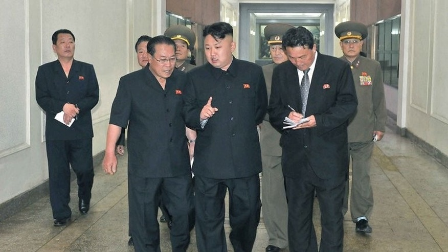 "This photo, released by North Korea's official Korean Central News Agency (KCNA) on June 18, 2013, shows N.Korean leader Kim Jong-Un (C) visiting a machine plant in North Phyongan Province. Kim has reportedly given copies of Adolf Hitler's ""Mein Kampf"" to his top officials, urging them to study it as a leadership skills manual."