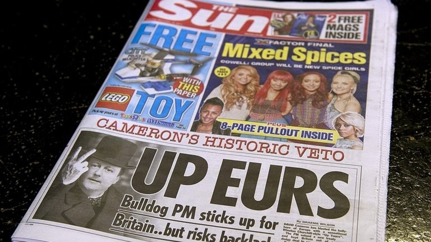 A copy of British tabloid The Sun on December 10, 2011. The chief foreign correspondent for Rupert Murdoch's top-selling British tabloid The Sun has been charged for allegedly paying public officials for information, prosecutors said on Tuesday.