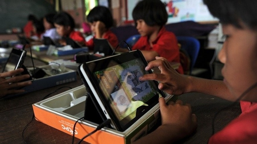 A student uses a tablet at Ban San Kong school in Mae Chan, in Thailand's northern Chiang Rai province. The disadvantaged students are part of an ambitious scheme by the kingdom to distribute millions of the handheld devices in its schools in a move supporters hope will boost national education standards.