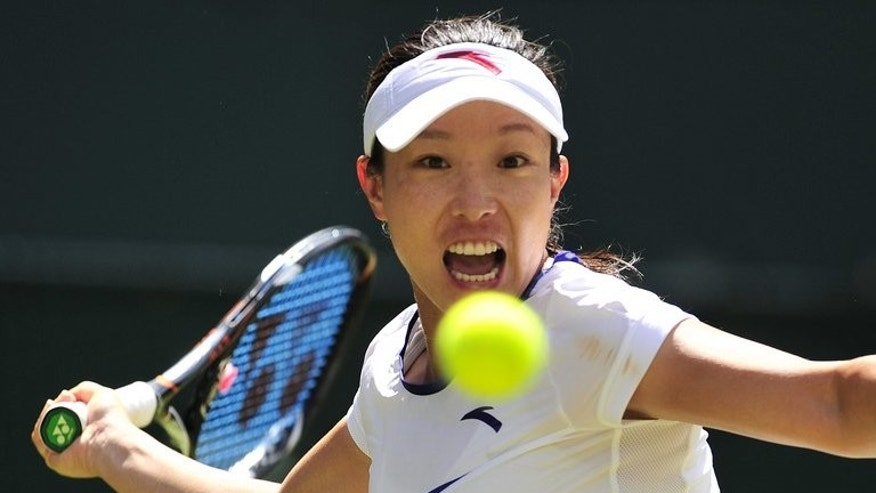 China's Zheng Jie plays a forehand shot during her 3rd round match against US player Serena Williams on day six of the 2012 Wimbledon Championships tournament, at the All England Tennis Club in Wimbledon, on June 30, 2012. Zheng, who will turn 30 next month, pushed world number one Williams to a tough three-setter with the American edging the decider, 9-7.
