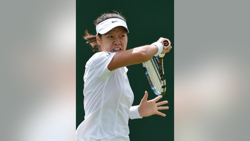 China's Li Na plays a shot during her first round match against Kazakhstan's Ksenia Pervak, on the first day of the 2012 Wimbledon Championships tournament, at the All England Tennis Club, on June 25, 2012. Li will go into Wimbledon next week in the unusual position of not being her country's favourite to progress into the second week.