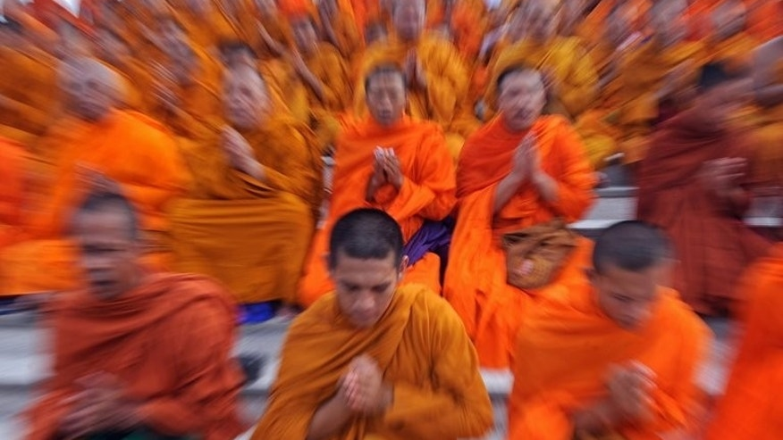 This file photo shows Buddhist monks praying in Bangkok, on May 16, 2010. The behaviour of Thailand's Buddhist clergy has been thrust under the spotlight after footage emerged of three monks flying in a private jet, wearing earphones and sunglasses and travelling with a Louis Vuitton luxury bag.