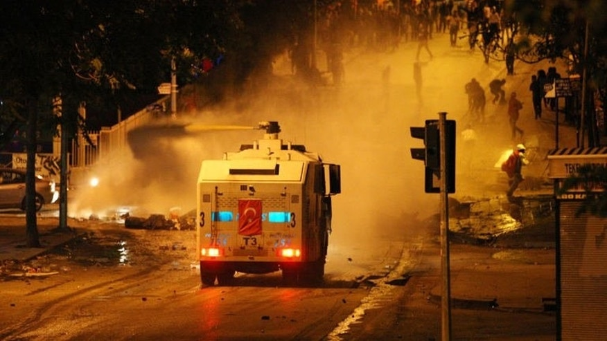 Police use a water cannon against anti-government protesters during a demonstration in Ankara on June 17, 2013.