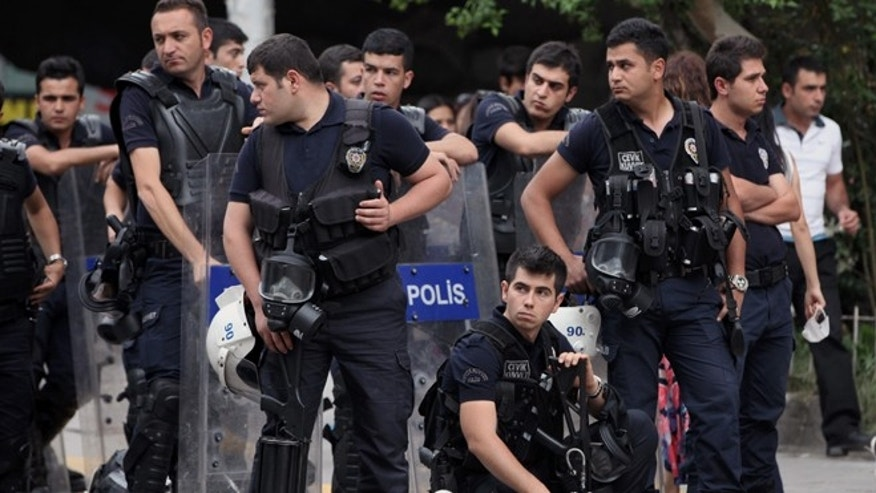 June 17, 2013: Riot police stand by near a rally by the labor unions in Ankara, Turkey. A day earlier, riot police cordoned off streets, set up roadblocks and fired tear gas and water cannons to prevent anti-government protesters from an effort to return to Taksim Square in Istanbul. Labor unions and political foes of Prime Minister Recep Erdogan rallied Monday by the thousands across Turkey, hoping to capitalize on weeks of protest that began as small-scale activism and parlay it into a chance to register broader discontent.