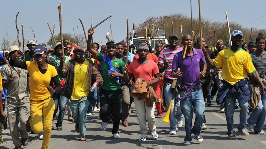 Striking Anglo American Platinum (Amplats) workers in Rustenburg last September. Up to 145,500 jobs and 60 percent of South Africa's platinum output could be a risk in coming years amid unrest and upheavals in the sector, economists at Nomura bank warned on Tuesday.