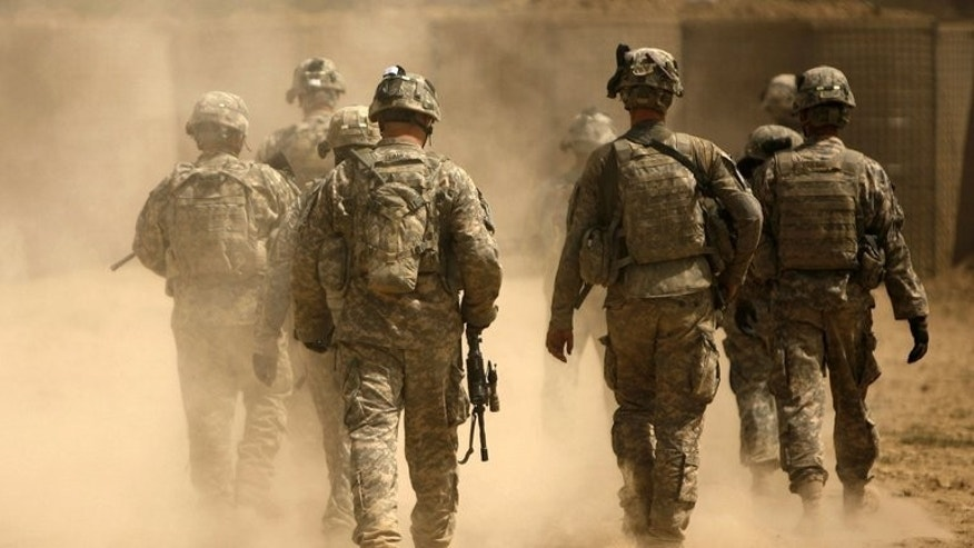 File photo shows US army soldiers leaving on a patrol from Combat Outpost Nolen in the village of Jellawar in the Arghandab Valley, Afghanistan on September 5, 2010. The United States on Tuesday welcomed the Taliban's decision to open an office in Qatar and senior US officials said they hoped to meet with their Afghan foes within days.