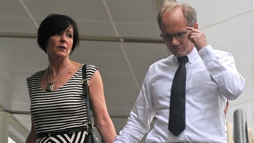 "Rick Todd and his wife Mary, pictured at the Subordinate courts in Singapore, on May 21, 2013. The family of an American scientist found hanged in Singapore last year dismissed on Tuesday the city-state's findings that he committed suicide as ""a sham and a cover-up"" for a murder."