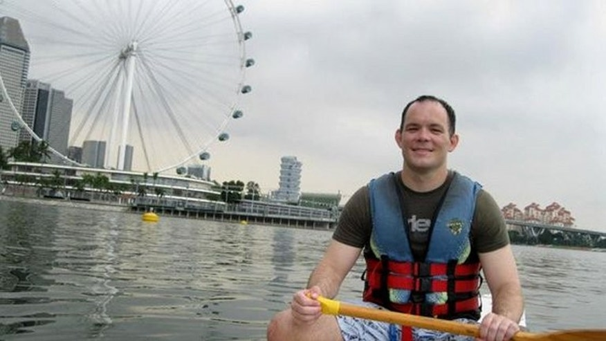 This undated file photo, released by Mary Todd in May 2013, shows her son, Shane Todd, a high-tech researcher who died in Singapore in June 2012. Lawyers for the Singapore government told a coroner's inquest on Monday that the scientist killed himself and was not murdered as his family claims.