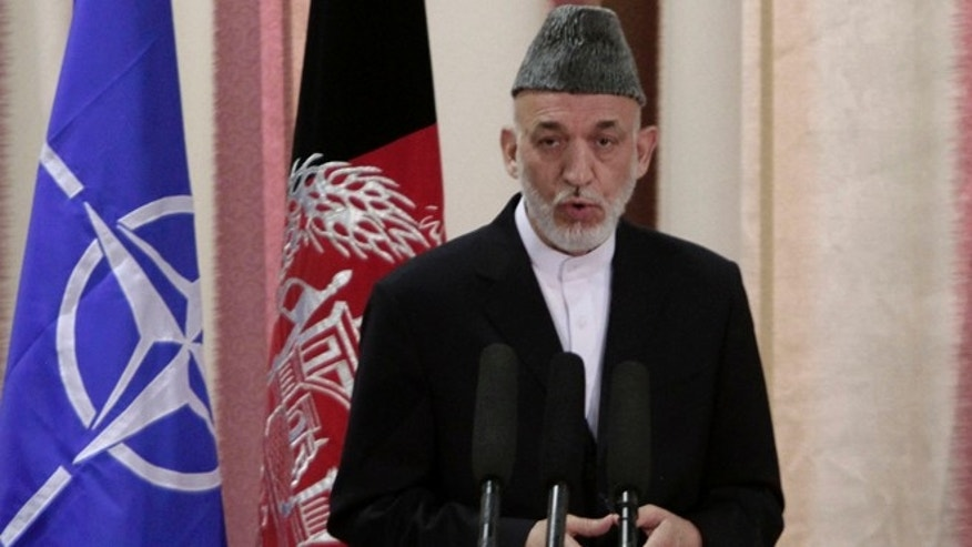 June 18, 2013: Afghan President Hamid Karzai speaks during a ceremony at military academy on the outskirts of Kabul, Afghanistan. Karzai announced at the ceremony that his country's armed forces are taking over the lead for security nationwide from the U.S.-led NATO coalition.