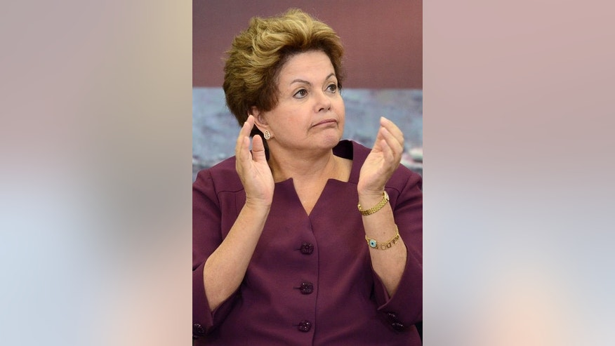 Brazilian President Dilma Rousseff applauds during a ceremony at Planalto Palace in Brasilia, on June 18, 2013. Rousseff said Tuesday that the voices of the hundreds of thousands of youths protesting across Brazil over the huge cost of hosting sporting events like the World Cup must be heard.