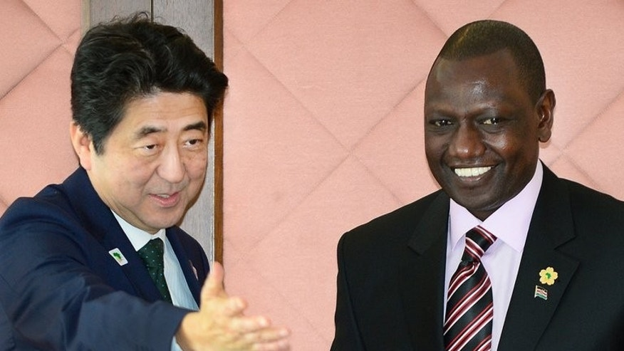 Japanese Prime Minister Shinzo Abe (left) welcomes William Ruto to bilateral talks in Tokyo on June 1. Ruto, 46, faces three counts of crimes against humanity for his role in deadly violence that erupted in Kenya after elections in late 2007 which claimed some 1,100 lives and displaced 600,000 people.