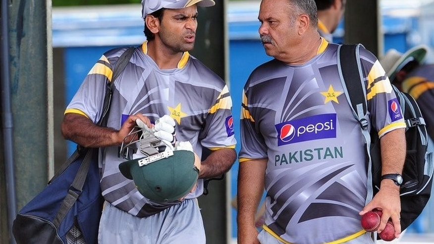 Pakistan coach Dav Whatmore (right) gives instructions to player Mohammad Hafeez during a practice session in Colombo on June 28, 2012. Whatmore said the team would be reviewed with an eye on building for the 2015 World Cup after their dismal showing at the Champions Trophy in England