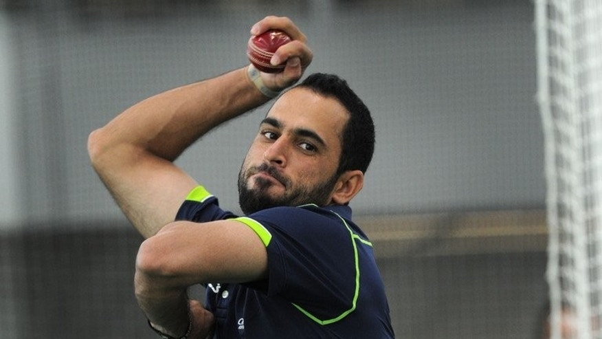 Leg-spinner Fawad Ahmed bowls at the indoor cricket nets at the MCG in Melbourne, on June 6, 2013. Ahmed was on Wednesday named on the Australia A squad for a tour of Africa beginning next month, despite also being in contention for selection for the Ashes series against England.