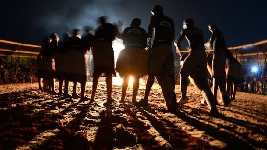 People perform a dance on August 3, 2012 during a festival in Ghanzi, Botswana. Hundreds of Botswana Bushmen who have won a temporary reprive against eviction from their land are now calling on the government to recognise their settlement, a rights group said on Wednesday.