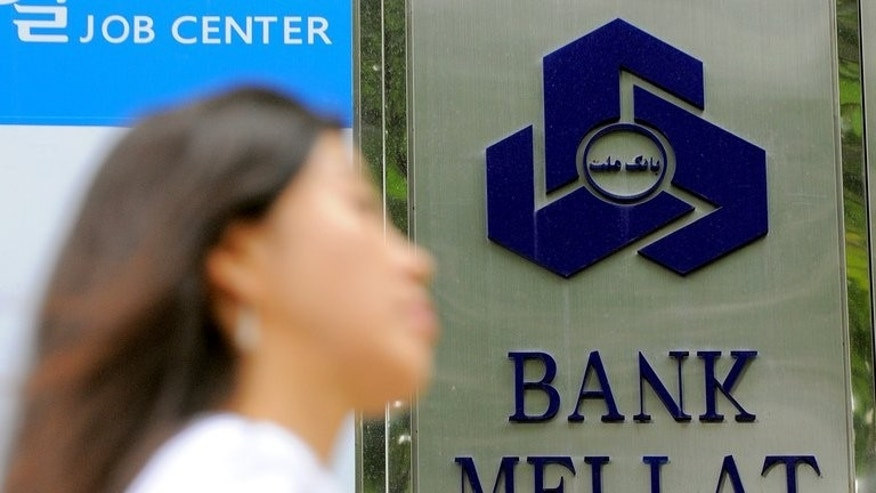 A woman passes a branch of Bank Mellat in Seoul in 2010. Britain's Supreme Court on Wednesday quashed government sanctions that had been imposed on Bank Mellat, Iran's largest private bank, due to its alleged links to Tehran's disputed nuclear programme.