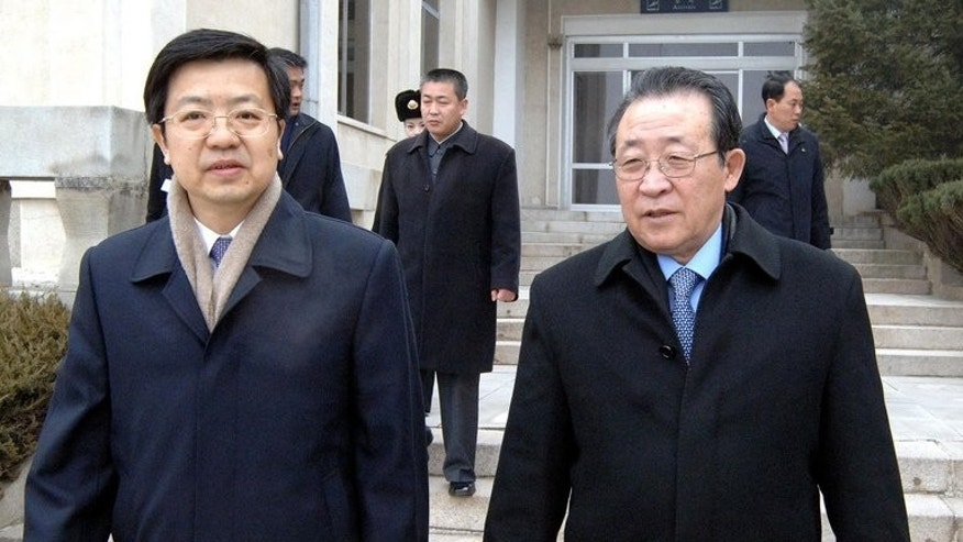 North Korean First Vice-Foreign Minister Kim Kye-Gwan (right) leaves Pyongyang airport for Beijing for the US-North Korea talks on February 21, 2012. Kim held talks with Chinese officials.