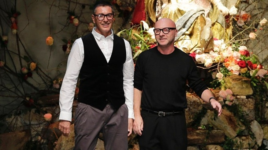 Jan. 12, 2013: In this file photo, Italian fashion designers Stefano Gabbana, left, and Domenico Dolce bow to the audience after presenting their Dolce & Gabbana men's Fall-Winter 2013-14 collection in Milan, Italy. A Milan court convicted fashion designers Domenico Dolce and Stefano Gabbana of tax evasion.
