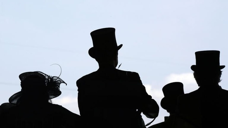 Racegoers watch the first race from Owners and Trainers balcony during the second day of Royal Ascot, in Berkshire, west of London, on June 19, 2013. Jockey James Doyle had not ridden a winner at Royal Ascot until Wednesday but the 25-year-old Englishman made up for it in style with a superb treble in front of an admiring Queen Elizabeth II to boot.