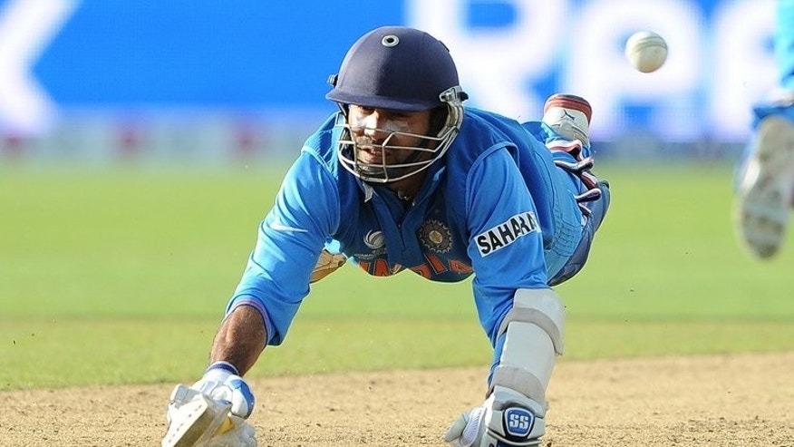 India's Dinesh Karthik during the Champions Trophy match against Pakistan on June 15, 2013. Group B winners India and Sri Lanka meet in the second semi-final in Cardiff on Thursday in a repeat of the 2011 World Cup final in Mumbai.