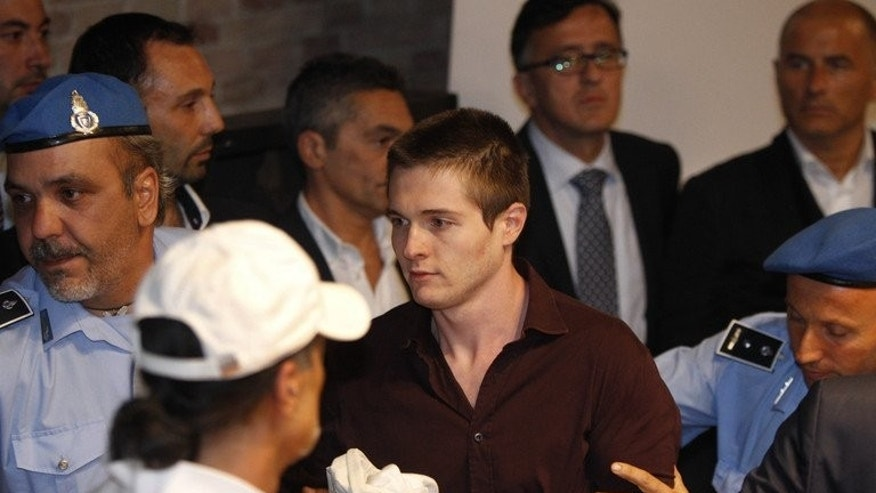 Raffaele Sollecito is taken away after his acquital along with co-defendant Amanda Knox over the murder of Meredigh Kercher, on October 3, 2011 in Perugia. Contradictions and illogical conclusions in the ruling mean DNA evidence will be re-examined from scratch and witnesses may be re-heard, Knox's lawyer says.