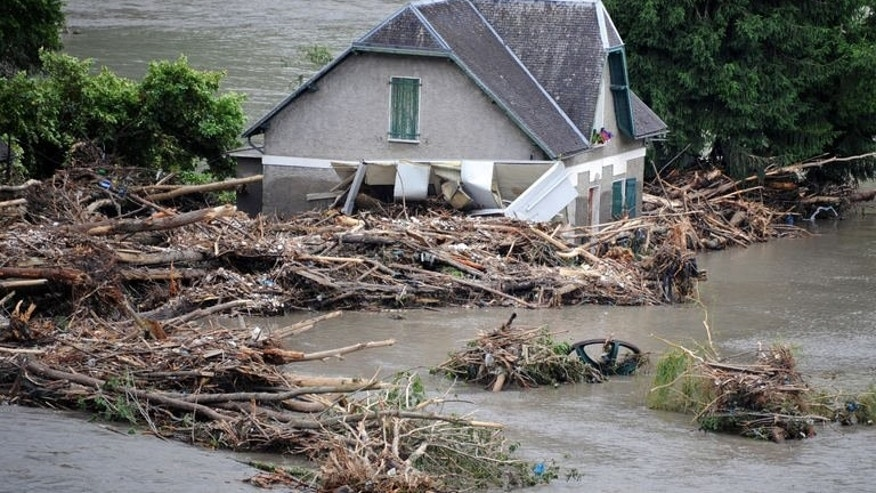 A flooded house is pictured one day after the village of Saint-Beat was submerged by flash floods on June 19, 2013. Flash floods in southwestern France claimed two elderly victims in the space of 24 hours as unseasonal storms caused havoc across huge swaths of the country on Wednesday.