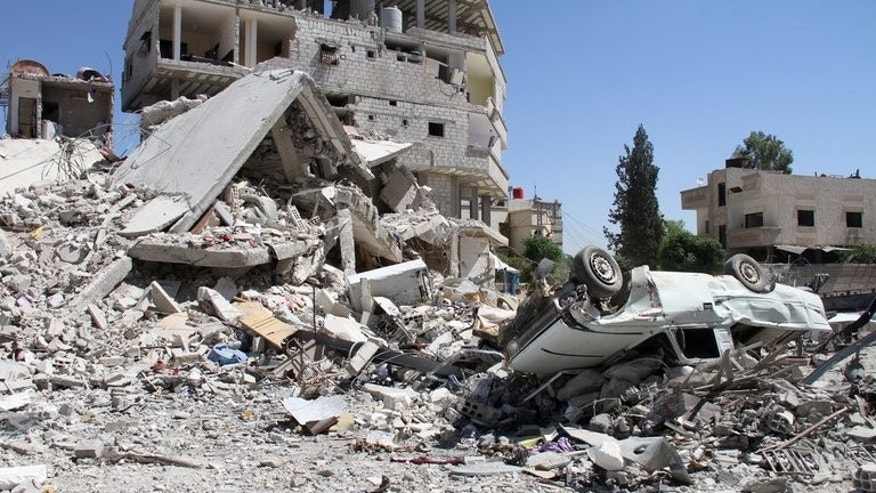 Destruction in Sbeneh, south of the Syrian capital Damascus on Sunday. Activists say the regime is trying to crush the rebellion on the outskirts of Damascus in order to cut off supply lines leading into rebel pockets inside the capital.
