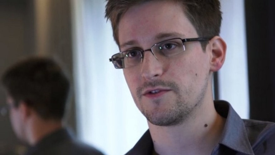 This still frame grab released to AFP on June 10, 2013 shows Edward Snowden speaking during an interview with The Guardian newspaper at an undisclosed location in Hong Kong. Iceland said Wednesday it has held informal talks with an intermediary of US intelligence leaker Snowden who reportedly may want to seek political asylum there.