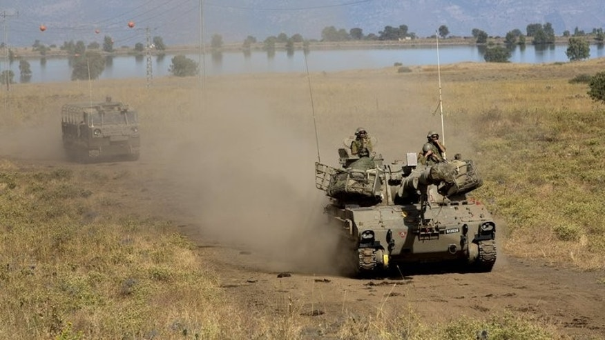 An Israeli army Cannon Unit maneuvers during a drill in the Israeli-annexed Golan Heights near the border with Syria on June 12, 2013. US plans to arm Syrian rebels have raised fears in Israel that the weapons could fall into the wrong hands, but analysts played down the threat -- provided no big guns are involved.