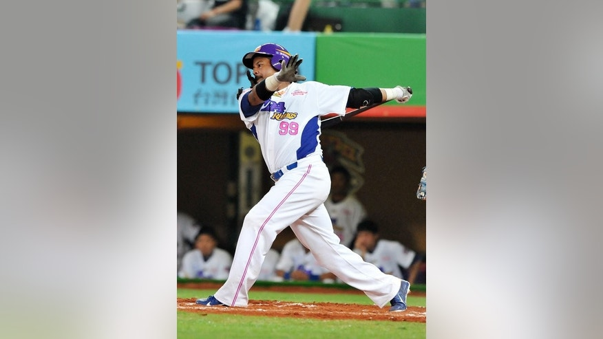 Manny Ramirez swings in his debut game for EDA Rhinos in Kaohsiung, southern Taiwan on March 27. The 12-time All-Star boosted attendance in the island's once-struggling Chinese Professional Baseball League as well as hitting the second-highest number of home-runs in the season so far.