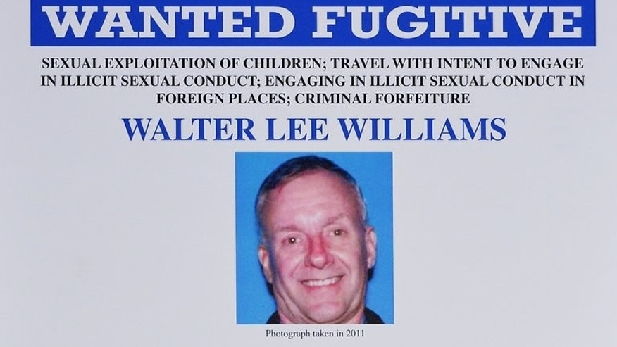 A photo shows a detail of a Federal Bureau of Investigation wanted poster for alleged child sex predator Walter Lee Williams, following a press conference on June 17, 2013 at the Newseum in Washington. Mexican officials said late Tuesday they had arrested Williams