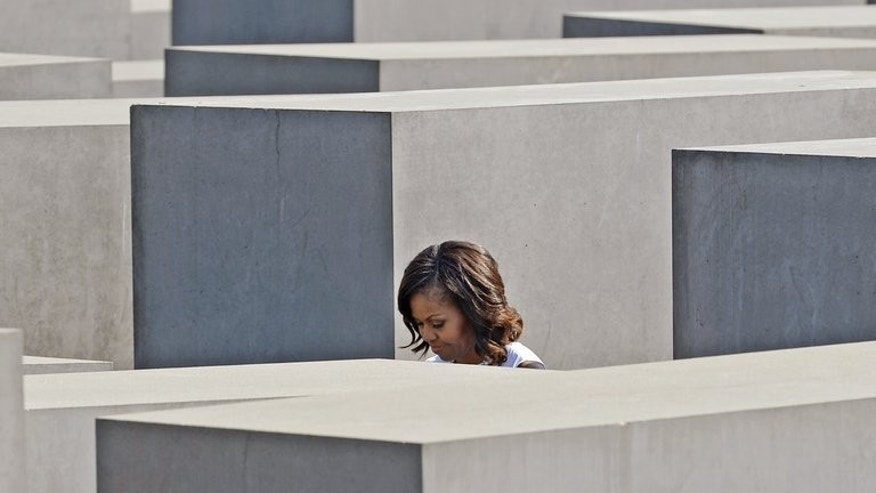 US first lady Michelle Obama visits the Holocaust Memorial in Berlin on June 19, 2013. Michelle Obama and her two daughters, Malia and Sasha, on Wednesday visited Berlin's Holocaust Memorial as part of a tour of key sites of Germany's troubled Nazi and Cold War history.