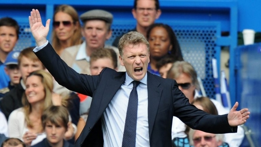 David Moyes watches former club Everton play Chelsea at Stamford Bridge on May 19. Champions Manchester United, Moyes's new club, will begin their title defence with a trip to League Cup winners Swansea, the English Premier League said on Wednesday as it announced the 2013/14 fixtures.