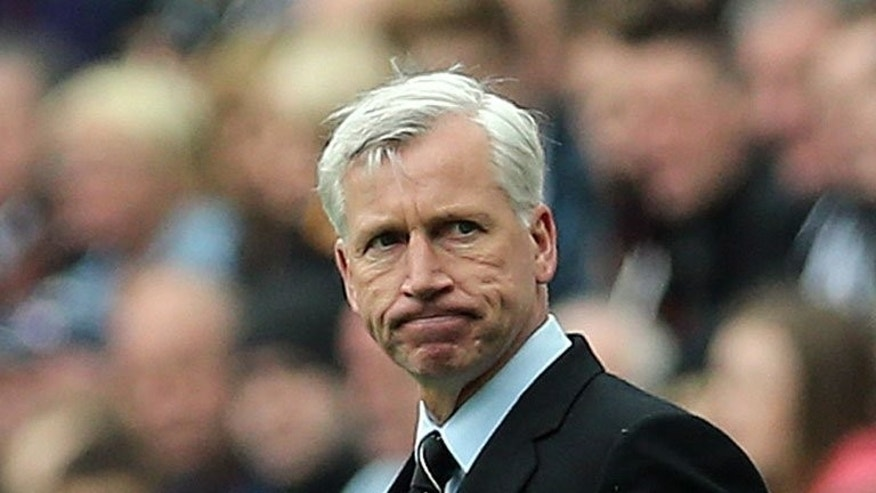 Alan Pardew at Newcastle's match against Arsenal at St James' Park on May 19. Pardew has vowed to stay at Newcastle United, he said in comments published on Wednesday, despite the controversial appointment of Joe Kinnear as director of football that has been interpreted as a threat to his job.