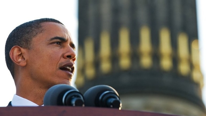 Then US Democratic presidential hopeful, Barack Obama, makes a speech in front of the Victory Column in Berlin on July 24, 2008. Obama will Wednesday invoke the Cold War history of German-US solidarity, on a long-awaited first visit to Berlin as president, but will face sharp questions on US spy snooping programmes.
