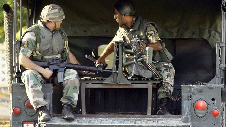 Lebanese soldiers deploy in Sidon's Abra suburb on Tuesday after a shooting spree by Salafist gunmen. The shooting by gunmen loyal to a controversial sheikh left one man dead and several wounded, the army and a security source said.